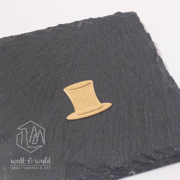 Zylinder aus goldfarbenem Metallic-Waschpapier gestanzt